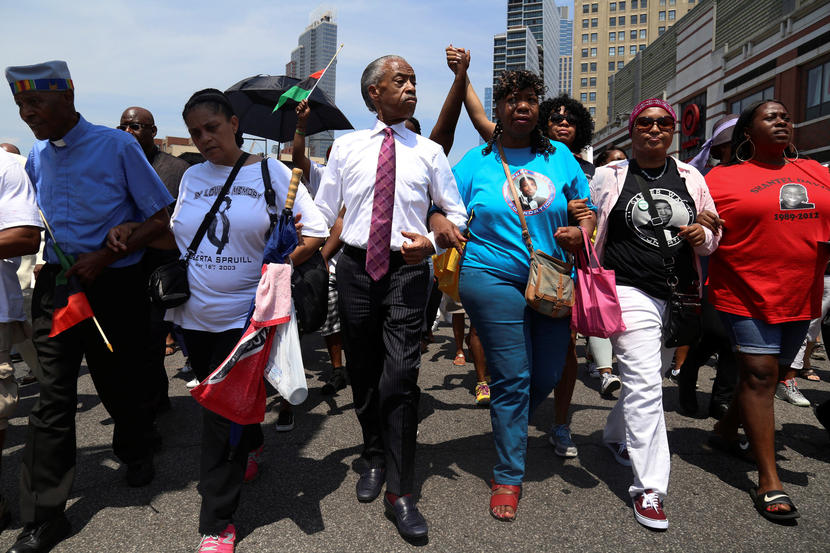 Rev. Sharpton and Gwen Carr, police chokehold victim Eric Garner's mother lead a march for Garner in Brooklyn in 2016, two years after Garner's murder.
